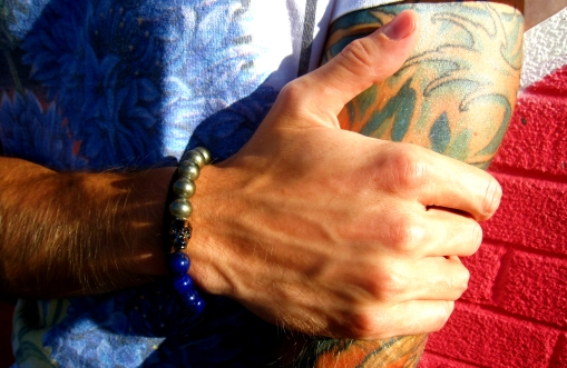 Ben is wearing a Lapis and Pyrite Bracelet, embellished with a Genuine Swarovski Crystal Skull