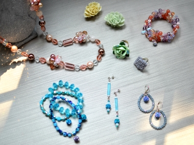 Crystal and Pearl necklace, crystal and glass bracelets with shamballa beads, resin and ceramic rings with swarovski, crystal earrings.